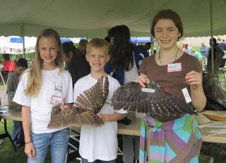 Three children attending a Youth Raptor Corps event